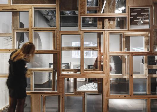 Wasteland exhibition featuring salvaged windows. Image © Rasmus Hjortshøj - COAST