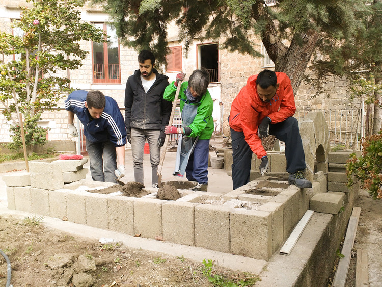 Building Beauty students constructing a stone bench they designed. In this program, construction is not an execution of a pre conceived blueprint, but an inherent part of the design process, where the design and its details unfold through its construction. Image © Or Ettlinger
