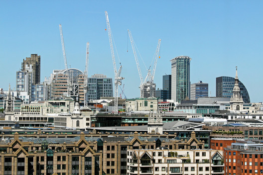 London cityscape with building construction sites in background. Image via Shutterstock/ By Ttatty