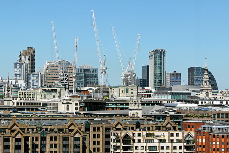 The UK Speeds Up Planning Approvals for Developments , London cityscape with building construction sites in background. Image via Shutterstock/ By Ttatty