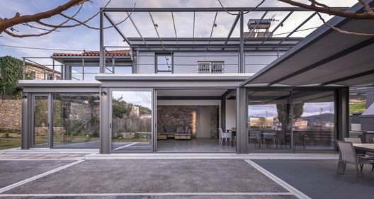 Vresthena Residential Extension / Spyros Tzinieris Architects