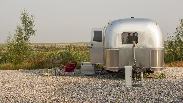 Example of an Airstream Trailer used as a Tiny House in the Netherlands. Image © HildaWeges Photography / Shutterstock