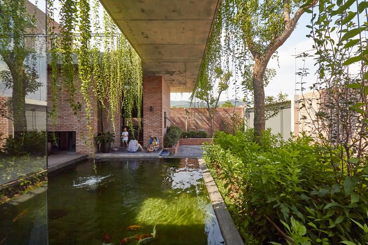Casa cortina verde / HGAA, © Duc Nguyen