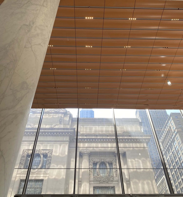 The terra cotta ceiling in the lobby is a deeper hue to give the space an intimate scale. Image Courtesy of KPF