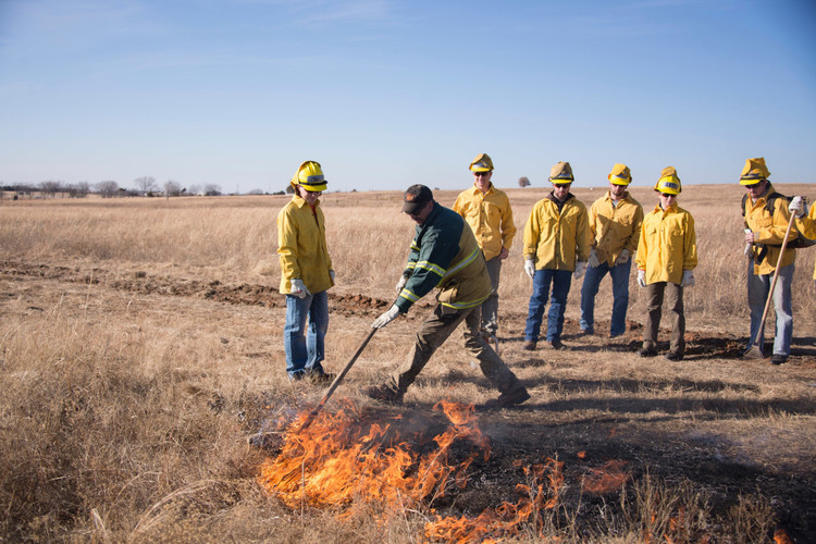 It's Time for Designers to Embrace Fire as the Ecological and Cultural Force That It Is, An instructor initiates a fire crew in the practice of spotfire training at the Oklahoma State University.. Image © T. Johnson