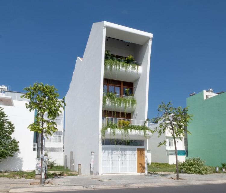 Casa ajardinada / Chơn.a, © Quang Chon