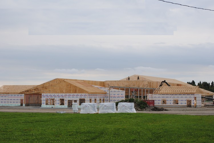 Walls and trusses by La Charpenterie in Quebec, Canada. Image Courtesy of QWEB