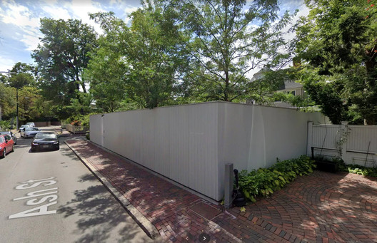 "9 Ash Street, formerly the ""Philip Johnson Thesis House"" is seen as a precursor to the Glass House, but is, unfortunately, protected by a privacy enclosure from street views. Image via Google Maps"