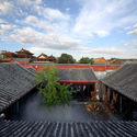 Looking into the open courtyard from above with the Lama Temple in background. Image © He Shu