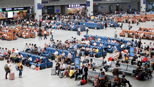 Passengers in the waiting room of Nanchang Railway Station, China. Image © humphery | Shutterstock