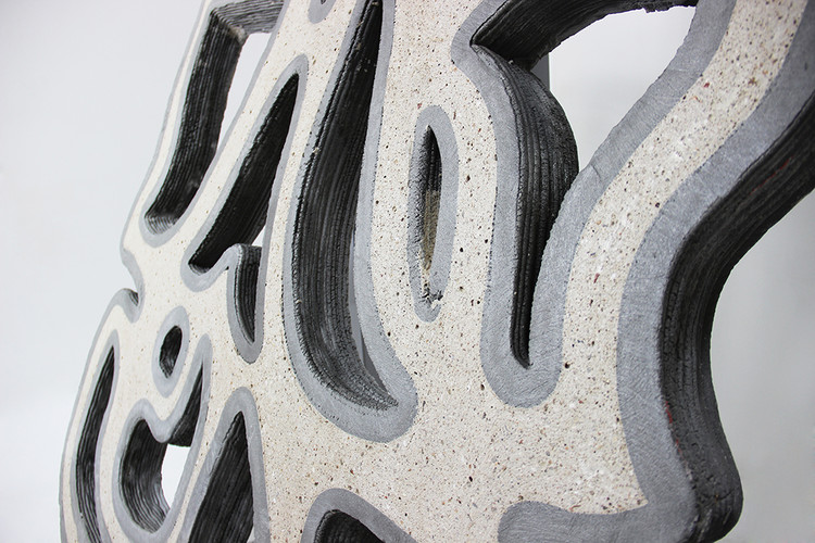 Facade prototypes: The use of two concretes, one printed and the other cast, also allows a play on the colors of the final object. Image Courtesy of XtreeE