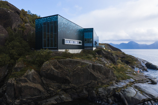 Custom Facade Panels Blend Arctic Salmon Center into the Norwegian Landscape