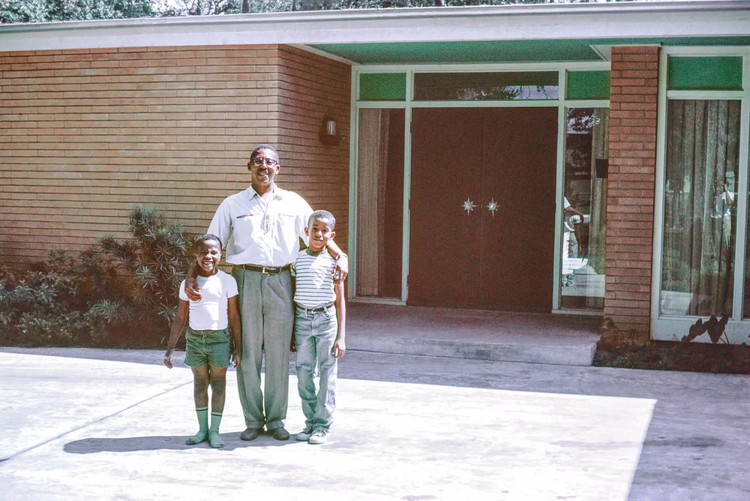 The Chase Residence: The History Behind One of Texas' Most Radical Houses, Architect John S. Chase with his sons Anthony (left) and John, Jr. (right). The trio stand in front of the Chase Residence, built in 1959. Image Courtesy of John and Drucie Chase Collection, African American Library at the Gregory School, Houston Public Library