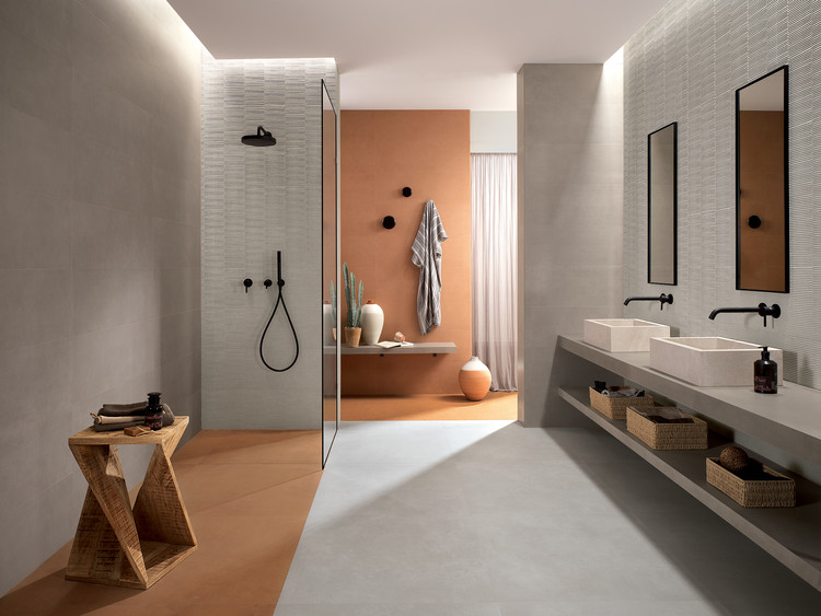 Merging Craftsmanship and Modern Materials: New Tile Collection by FAP Ceramiche, Warm Terracotta and elegant Ombra and Vento grey tiles bring shape to this bathroom. The 3D Slot Vento motif covers the walls of the shower and washbasin for added texture. Image Courtesy of FAP Ceramiche