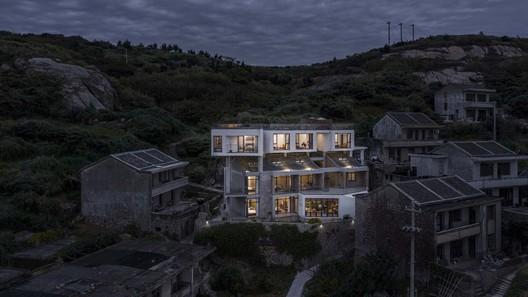 aerial night view. Image © Weiqi Jin