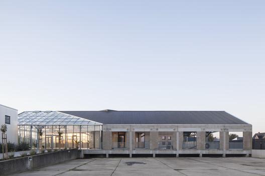 HACHIKO Warehouse Refurbishment / WE-S architecten
