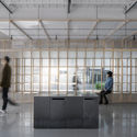 Translucent cabinet walls provoke peeking and interaction between inside and outside. Image © WDi