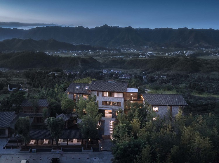 Southside bird's view, showing the resort corresponding with distant mountains. Image © Yilong Zhao