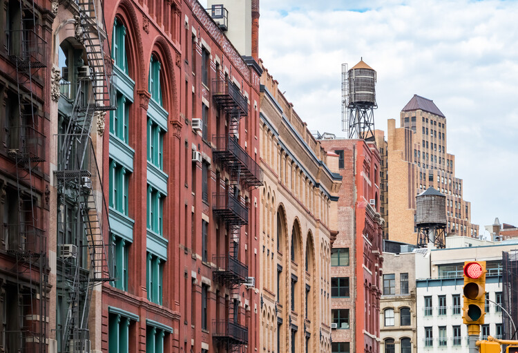 New York City Promises Affordability Through Rezoning But Delivers Gentrification, View of the old buildings on Franklin Street in the Tribeca neighborhood of Manhattan, New York City NYC. Image via Shutterstock/By Ryan DeBerardinis