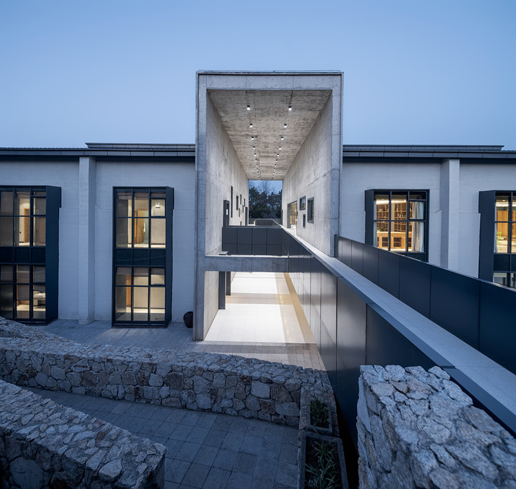 Conference centre renovated from granary with a double first floor responding to the site. Image © Qingshan Wu