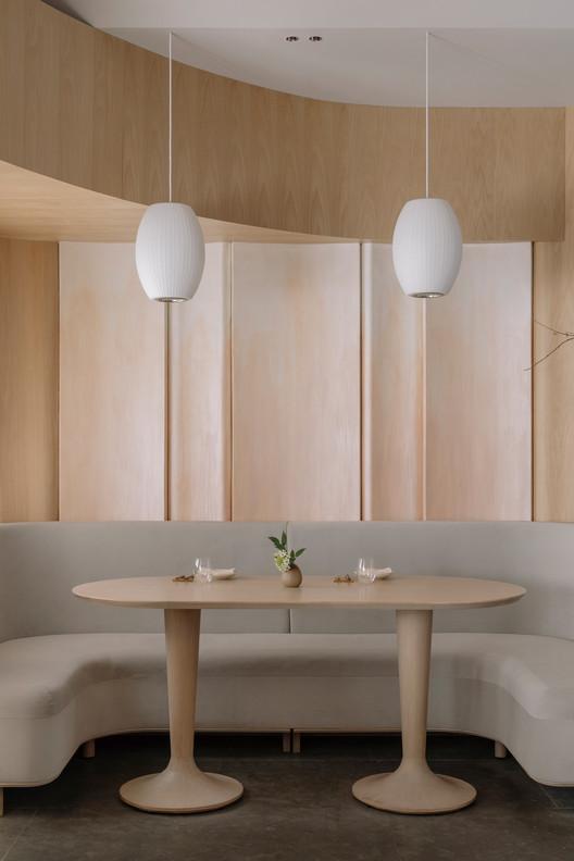 Orange painting dinning wall. Image © Wen Studio