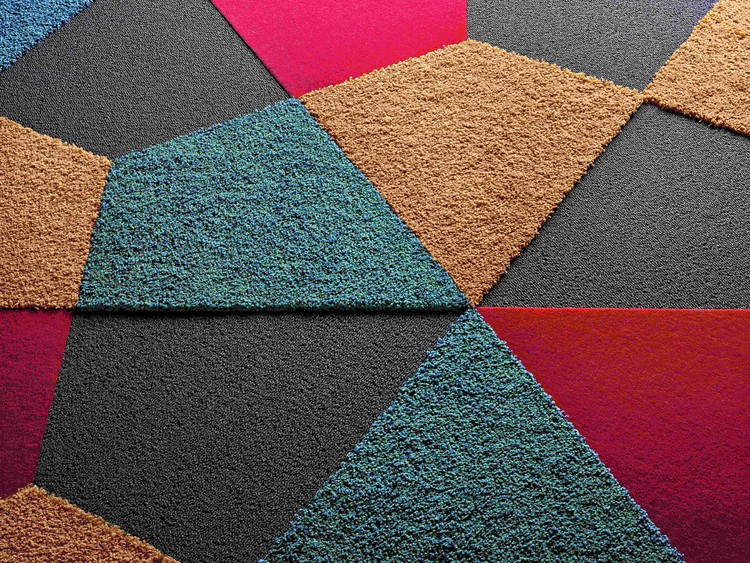 Vorwerk floor coverings are committed to developing acoustic tiles that make a lasting impression - through their range of colors, varied shapes and variety of surfaces.  Image courtesy of Vorwerk