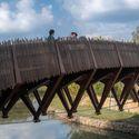 pedestrian bridge as a place for villagers' social communication. Image © Timeraw Studio