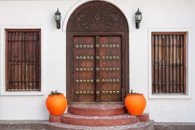 Ornately carved wooden doors of Swahili architecture.  Image © Ehrman Photographic via Shutterstock