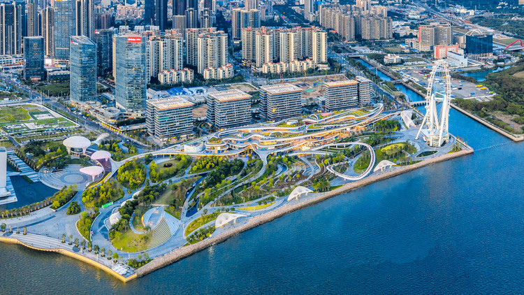 Overall aerial view of OCT OH BAY East Waterfront Retail Park, Urban Business Center, Central Plaza, Waterfront Cultural Park, and the Bay Glory Ferris wheel. Image © Yanlong Tong