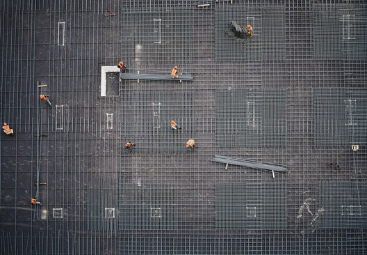 Photo of a construction site taken from a higher building. Image © Hama Advertising Agency, Sulaymaniyah, Iraq Via unsplash
