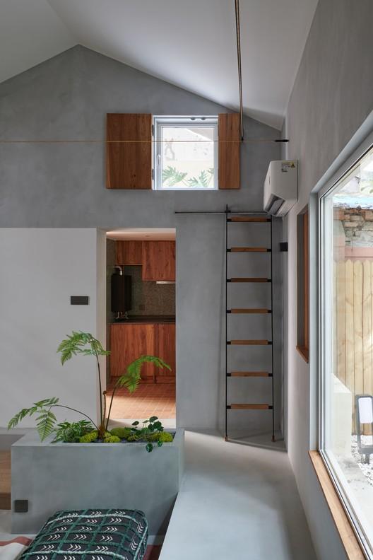 Teil des Wohnzimmers.  Bild © Hao Chen