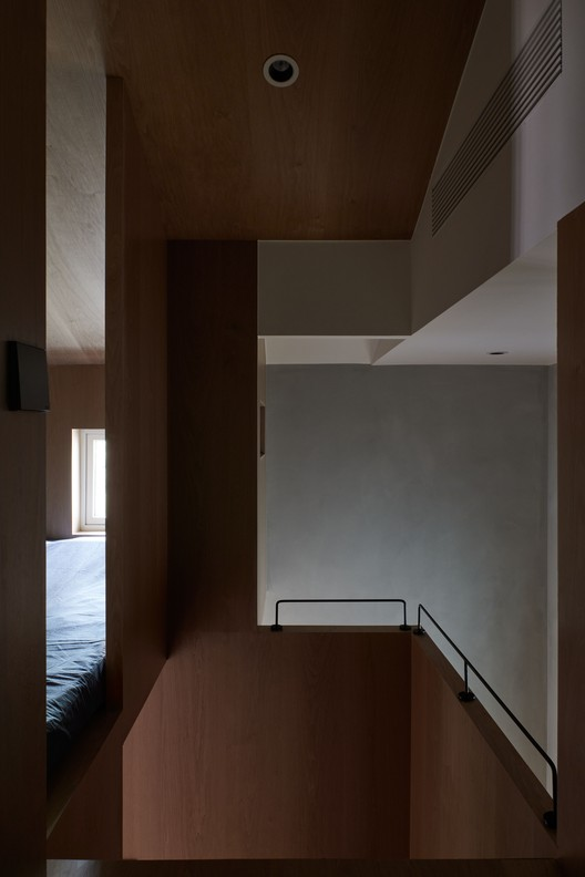 Treppe vom Schlafzimmer.  Bild © Hao Chen