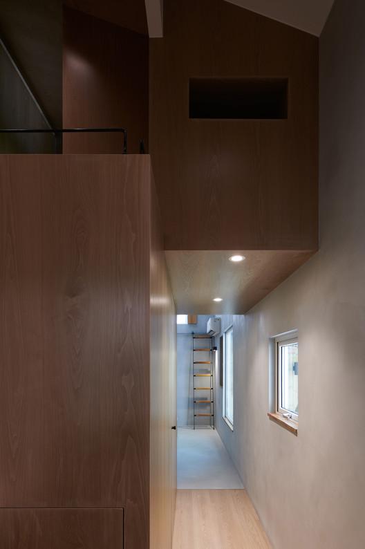 Durchgang zum Schlafzimmer.  Bild © Hao Chen
