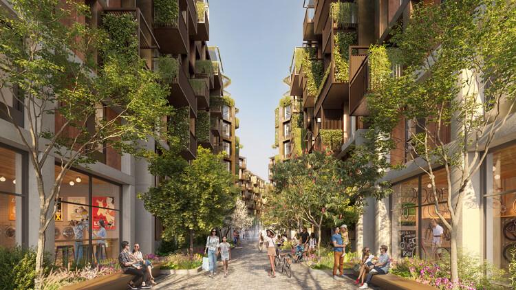 Вид на жилой двор.  Ряд небольших двориков по направлению к внутренней части участка, которые обозначают переход между общественными и частными пространствами.  Изображение © Foster + Partners