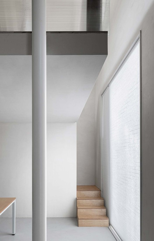 staircase and window.  Image © Xiaowen Jin