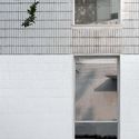 detail of the facade.  Image © Xiaowen Jin